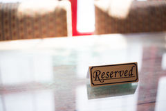 Reserve sign on table Royalty Free Stock Photos