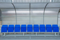 Reserve and staff coach bench in sport stadium Stock Photo