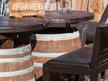 Reserved barrel shaped table in mountain chalet Royalty Free Stock Images