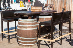 Reserved barrel shaped table in mountain chalet Stock Photos