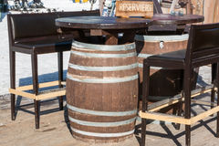 Reserved barrel shaped table in mountain chalet Stock Image
