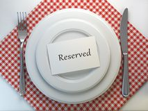 Free Reserved Card On A Restaurant Table Setting. Top View. Mock Up. Royalty Free Stock Photo - 128709905