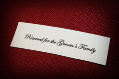 Reserved for the grooms family sign on a church pe Stock Photo