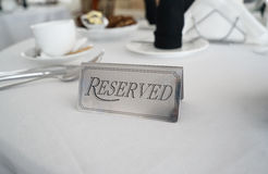 Reserved label on the white tablecloth Royalty Free Stock Photo