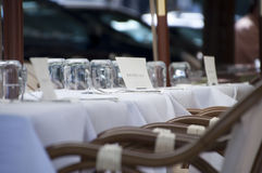 The reserved little table in street cafe. Cafe little table with the plate is reserved on the street under awnings. Prague. Czech Republic royalty free stock photo