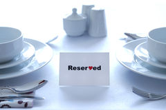 Reserved for lovers. Table setting in a restaurant with a reserved sign Royalty Free Stock Photography