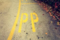 Reserved parking area in Italy delimited by yellow lines Stock Photography