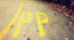 Reserved parking area in Italy delimited by yellow lines Stock Images