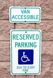 Reserved parking sign. A parking sign signifying van accessibility and disabled patrons only stock photo