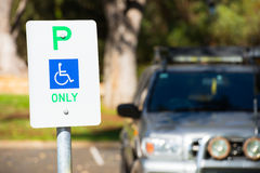 Reserved parking sign outdoor for disabled Stock Photos