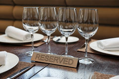 Reserved plate on an arranged table Royalty Free Stock Image