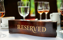 Reserved plate on a restaurant table Royalty Free Stock Image