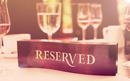 Reserved plate on a restaurant table, toned Stock Photo