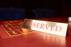 Reserved plate on a table. In a casino Stock Image