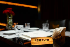 Reserved plate on a table. With flowers in restaurant Stock Photo
