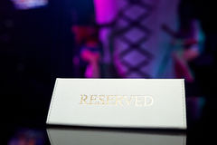 Reserved plate on the table. In a restaurant Royalty Free Stock Photos