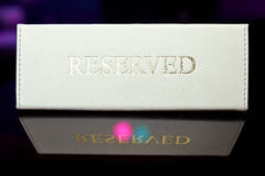 Reserved plate on the table. In a restaurant Stock Images