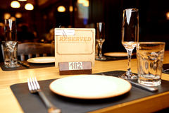 Reserved plate on the table. In a restaurant Stock Photography