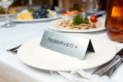 Reserved plate on a table. In a restaurant Stock Photo