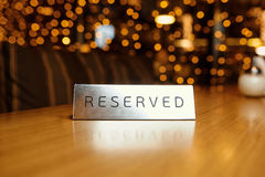 Reserved plate on a table. In a restaurant Stock Image