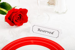 Reserved Restaurant Table with Red Rose Stock Photo