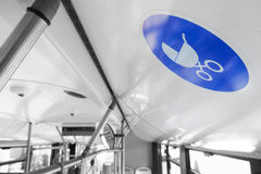 Reserved seat label onboard bus for baby carriage Stock Photography