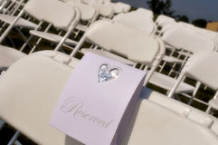Reserved Seats at Wedding. A reserved sign on a chair at a wedding Royalty Free Stock Photography