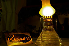 Reserved Sign. On table with lamp Royalty Free Stock Photo