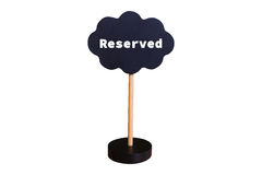 Reserved sign on blackboard with stand on white background Stock Photos