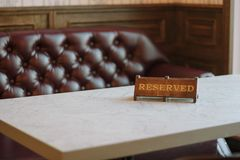 Reserved sign in a Cafe or restaraunt interior.  stock images