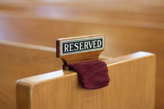 Reserved sign on church pew Royalty Free Stock Photo