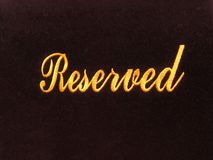 Reserved sign  on dark background / reservation concept in restaurant Stock Images