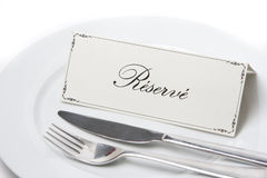 Reserved sign in french with fork and knife Stock Image