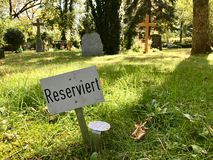 Reserved sign on a plot in a graveyard Stock Photography