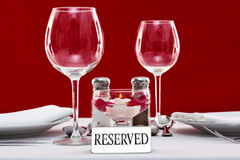 Reserved sign on a restaurant table royalty free stock images