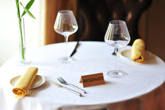 Reserved sign on a restaurant table Stock Photos
