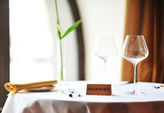 Reserved sign on a restaurant table.  stock photos