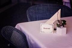 Reserved sign on restaurant table Royalty Free Stock Image