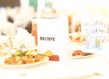 Reserved sign on a restaurant table Royalty Free Stock Image
