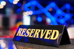 Reserved sign on a restaurant table Royalty Free Stock Photo