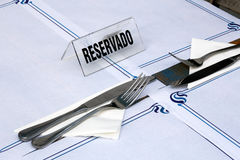Reserved sign on a restaurant table Stock Image