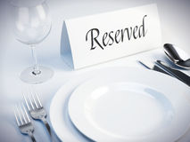 Reserved sign on a restaurant table. 3d render Royalty Free Stock Images