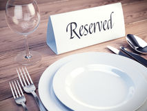 Reserved sign on a restaurant table. 3d render Royalty Free Stock Image