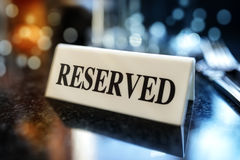 Reserved sign on restaurant table Royalty Free Stock Photo