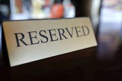 Reserved sign on table. In a restaurant Stock Images