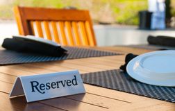 Reserved sign on a table Stock Photography