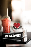A Reserved Sign On A Table In Restaurant Royalty Free Stock Images