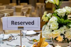 Reserved sign at a table stock images