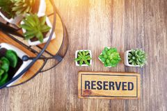 Reserved sign on top of a wooden table in a restaurant Royalty Free Stock Photo