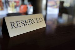 Reserved sign on wooden table. In restaurant Royalty Free Stock Images
